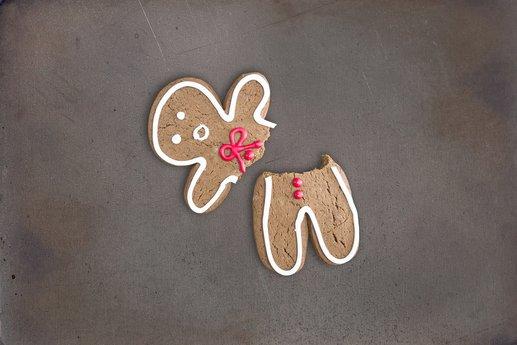 Broken gingerbread cookie on baking tray