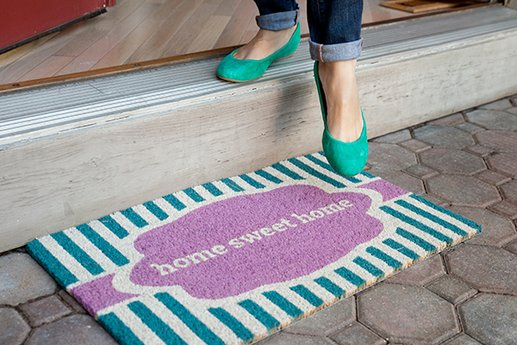 Home Sweet Home doormat at a home's entry