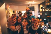 Group of people huddled for selfie at Halloween party