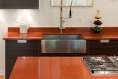 Red IceStone countertop in a kitchen