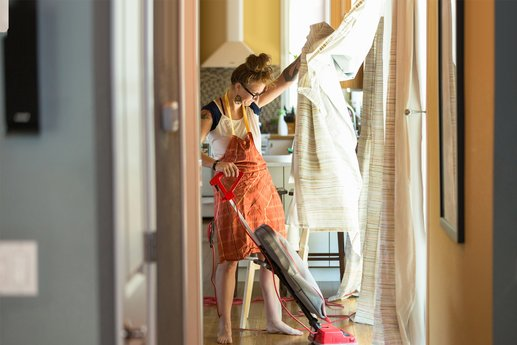Woman vacuuming her house