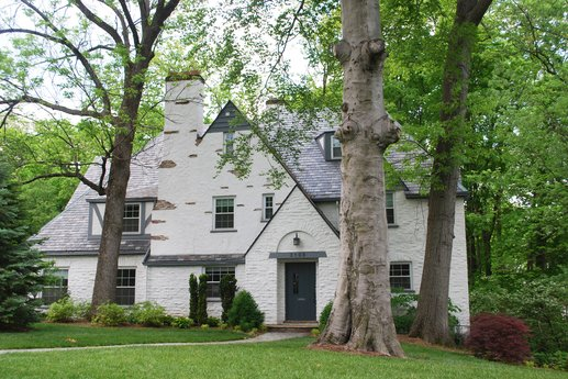 Gray home exterior and tree-filled yard