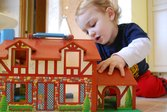 Kid playing with dollhouse