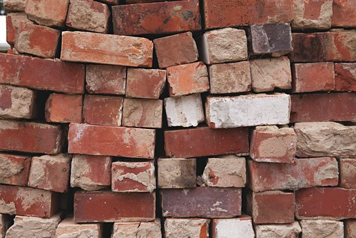 Stack of weathered red bricks