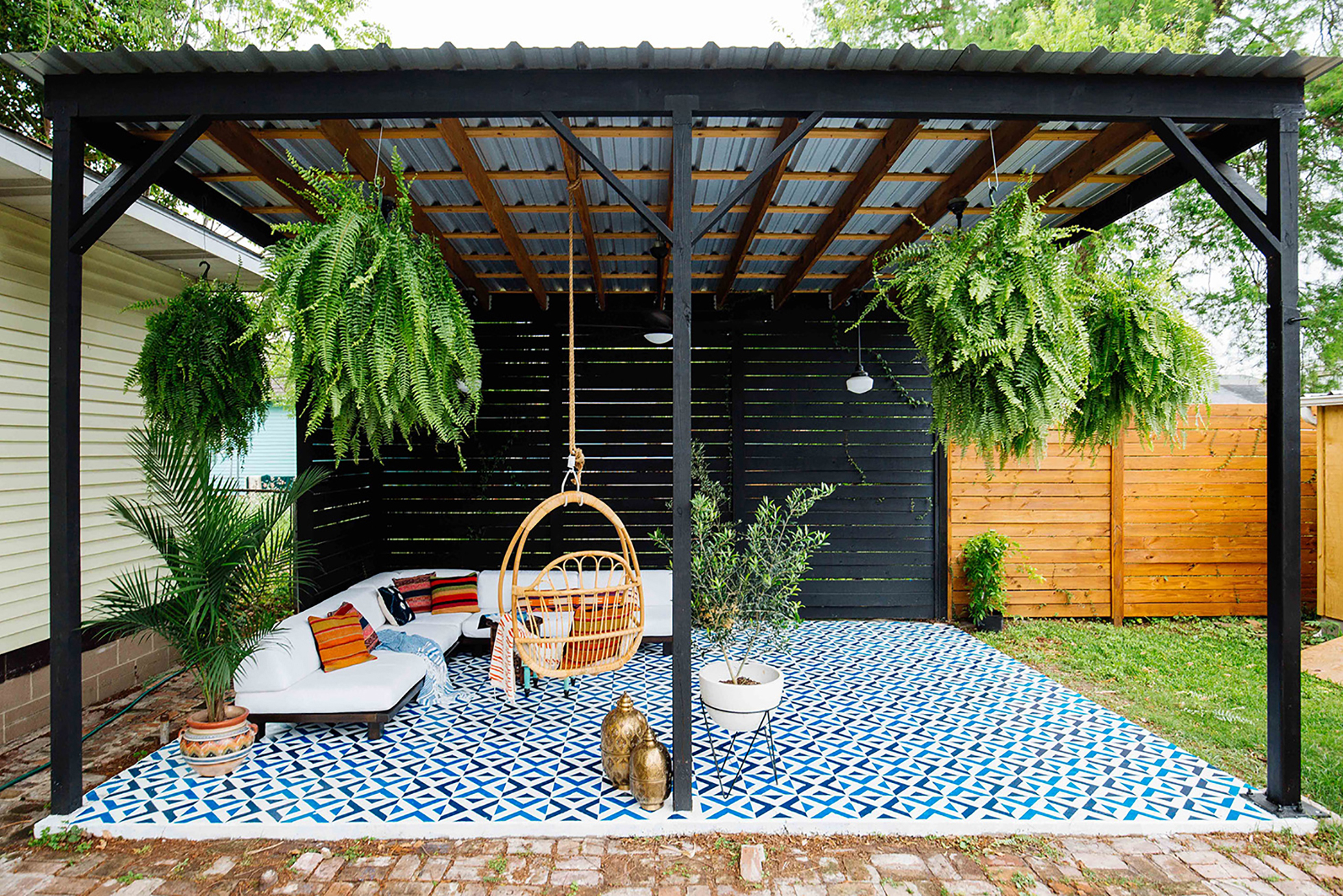 A covered patio with painted concrete floor