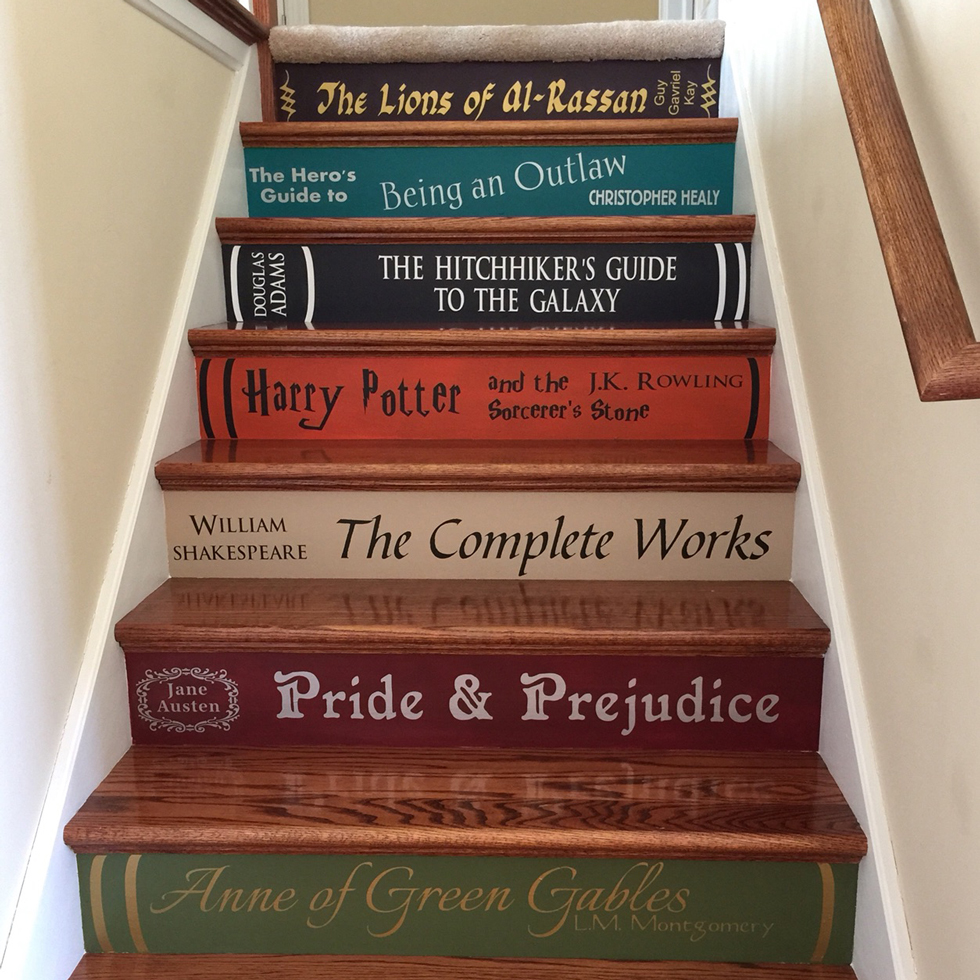 Book title decals on an interior staircase