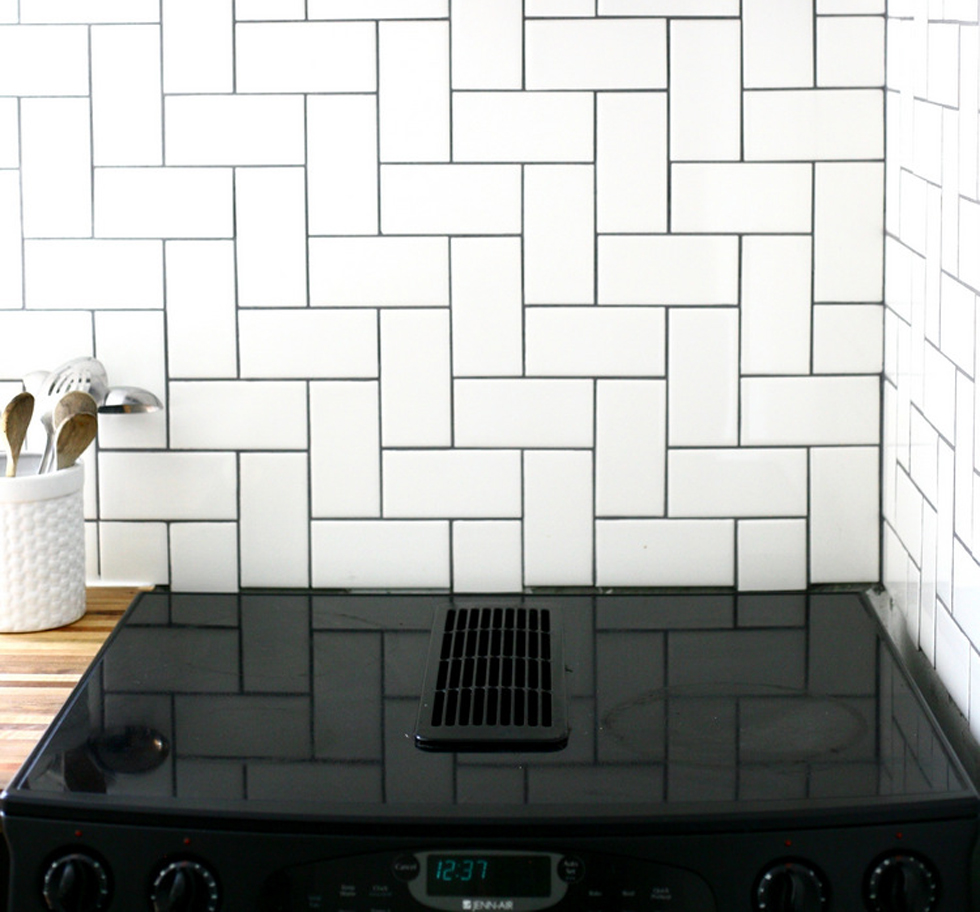 Stacked herringbone tile backsplash in a kitchen