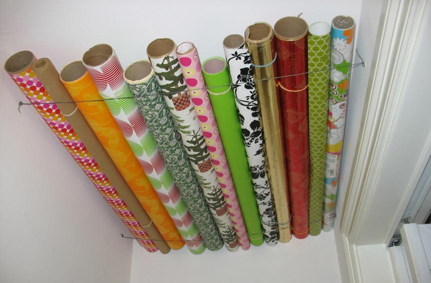 Wrapping Paper Stored on Closet Ceiling| Storage Solutions