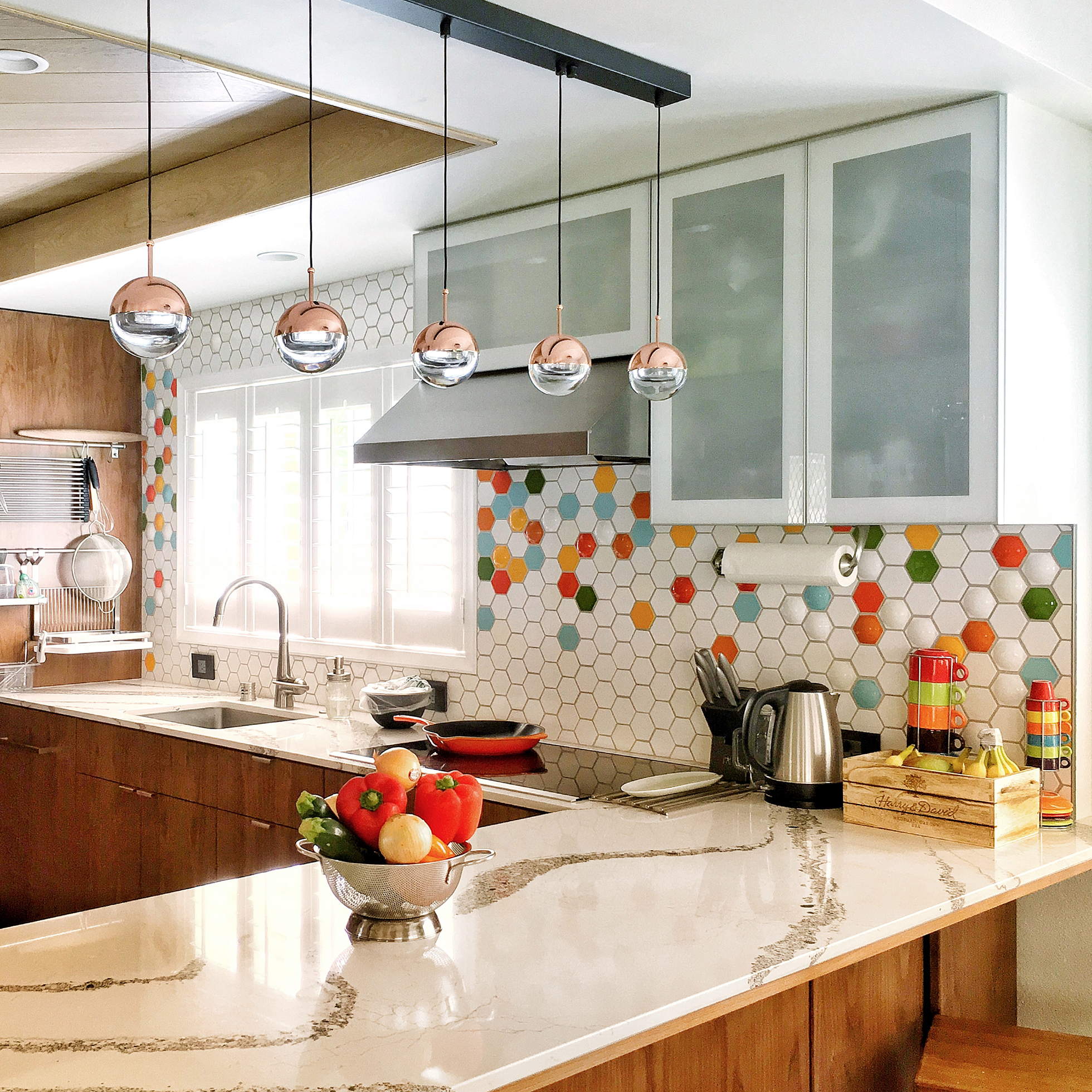 Kitchen with multi-color hex tile and modern accents