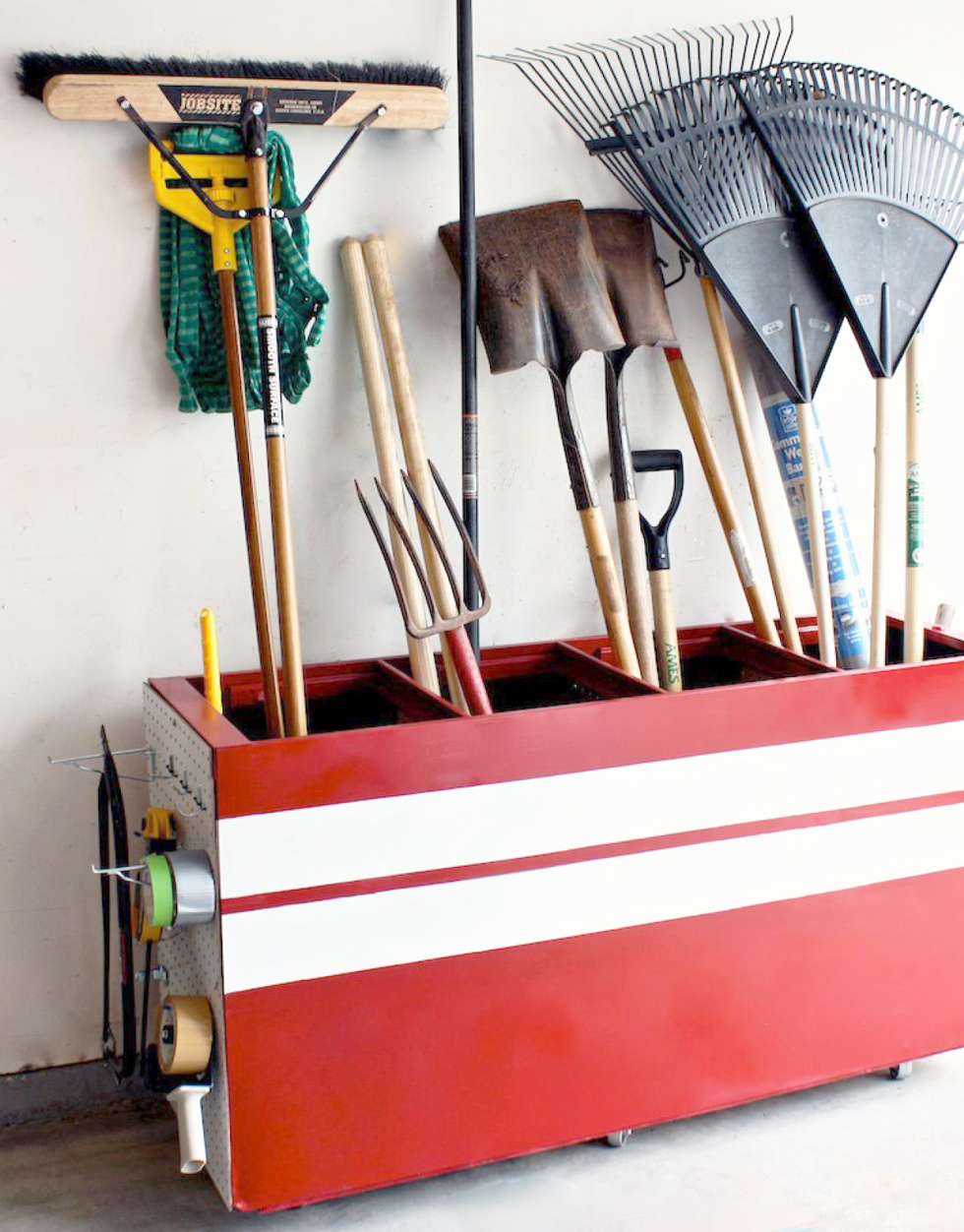 Red filing cabinet turned rolling tool storage cart