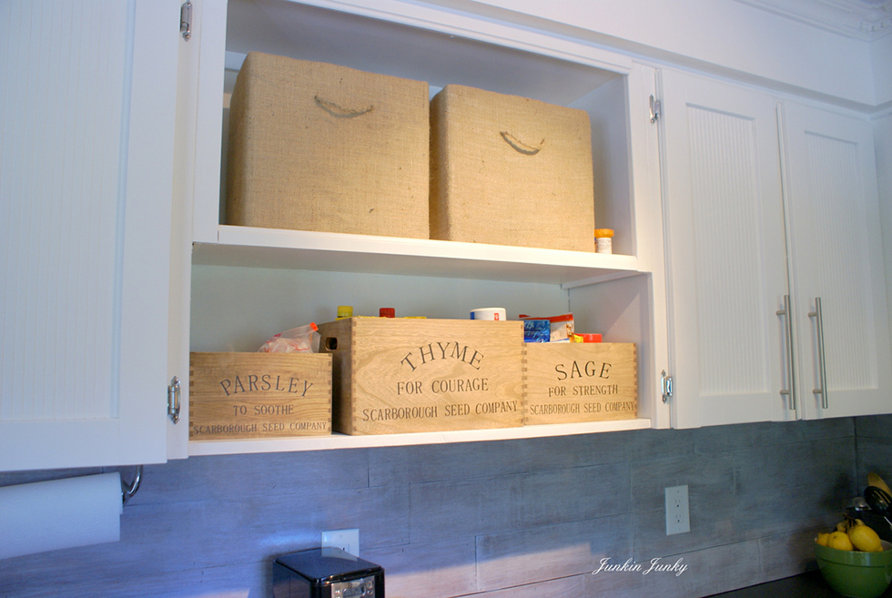 Bins decorate and serve as storage in a transitional kitchen