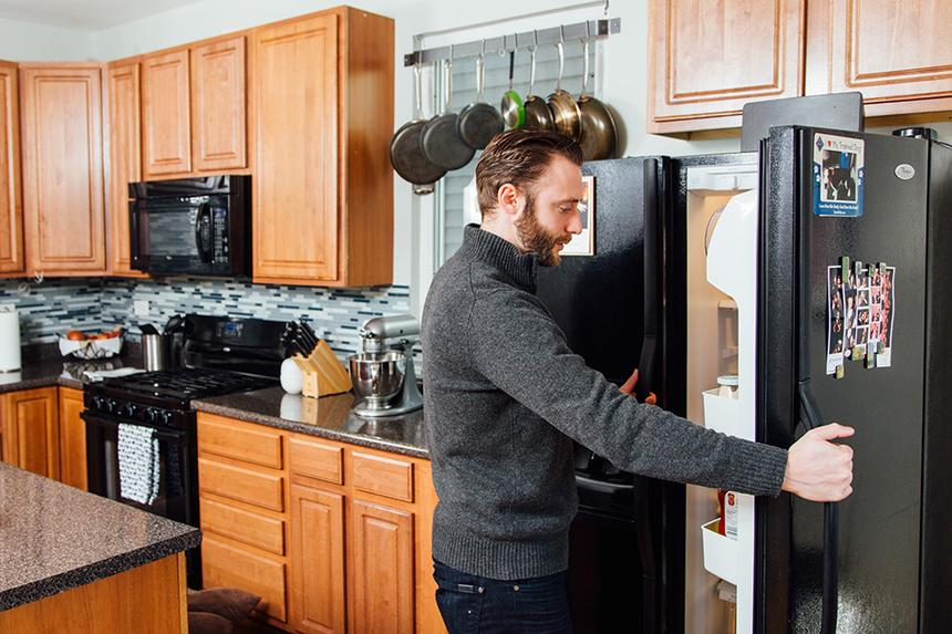 Grigory Pekarsky opening his refrigerator