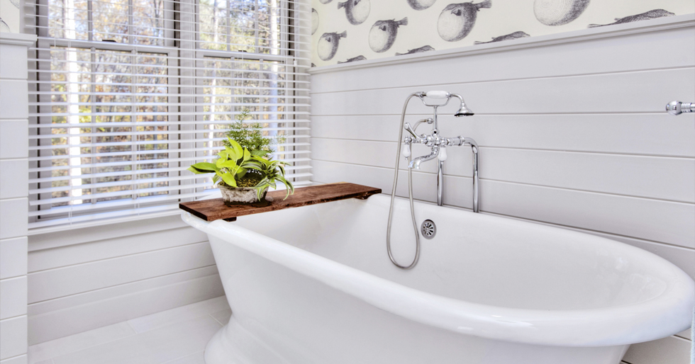 A white cast iron tub in a white bathroom