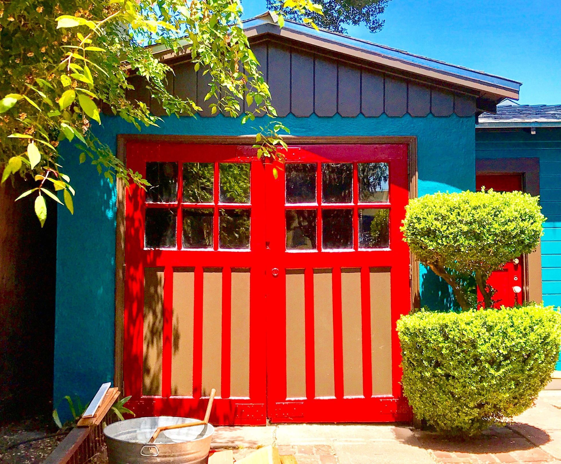 Blue and red painted detached garage