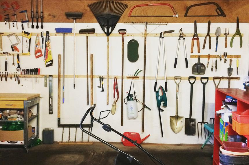 Lawn tools hanging in a garage
