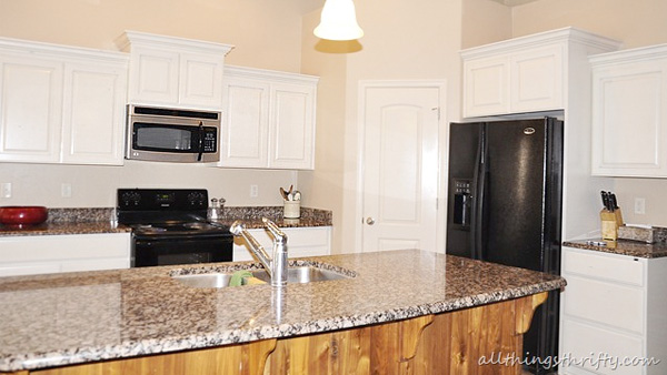 Kitchen cabinets painted pro-style by home blogger