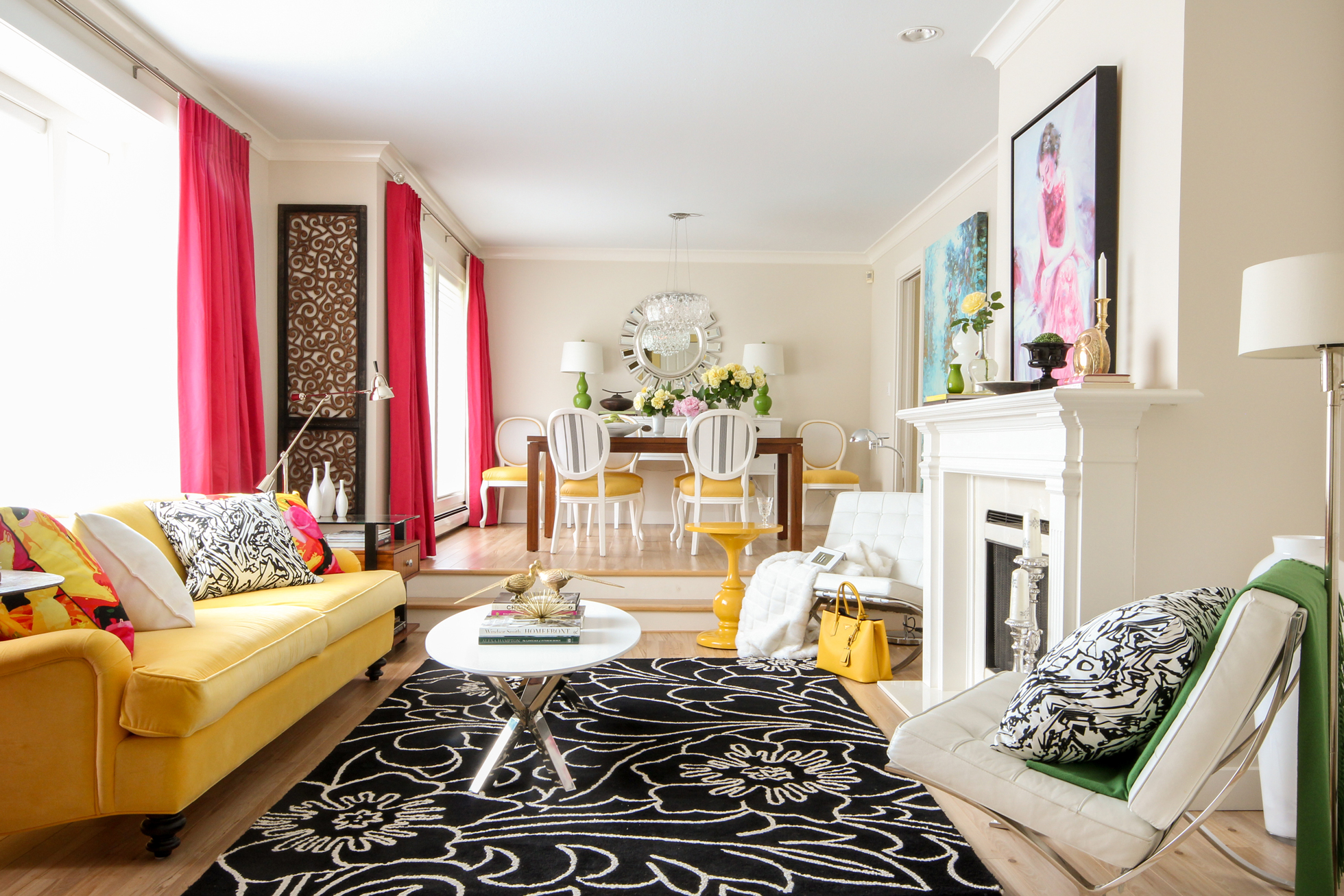 A bright living room with pink shades, yellow furniture