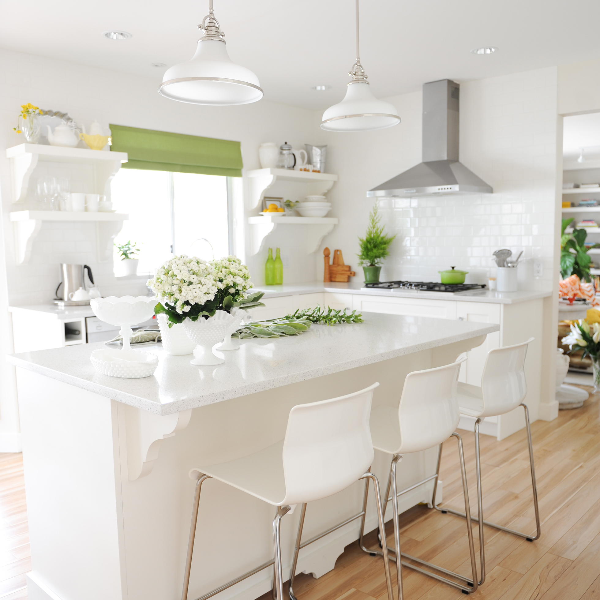 A White Bright Kitchen With Green Curtains And Accents