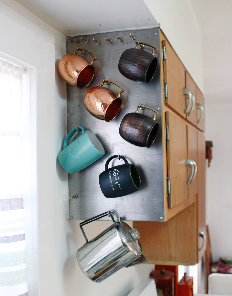 Mugs organized alongside cabinets | Winter Home Improvement