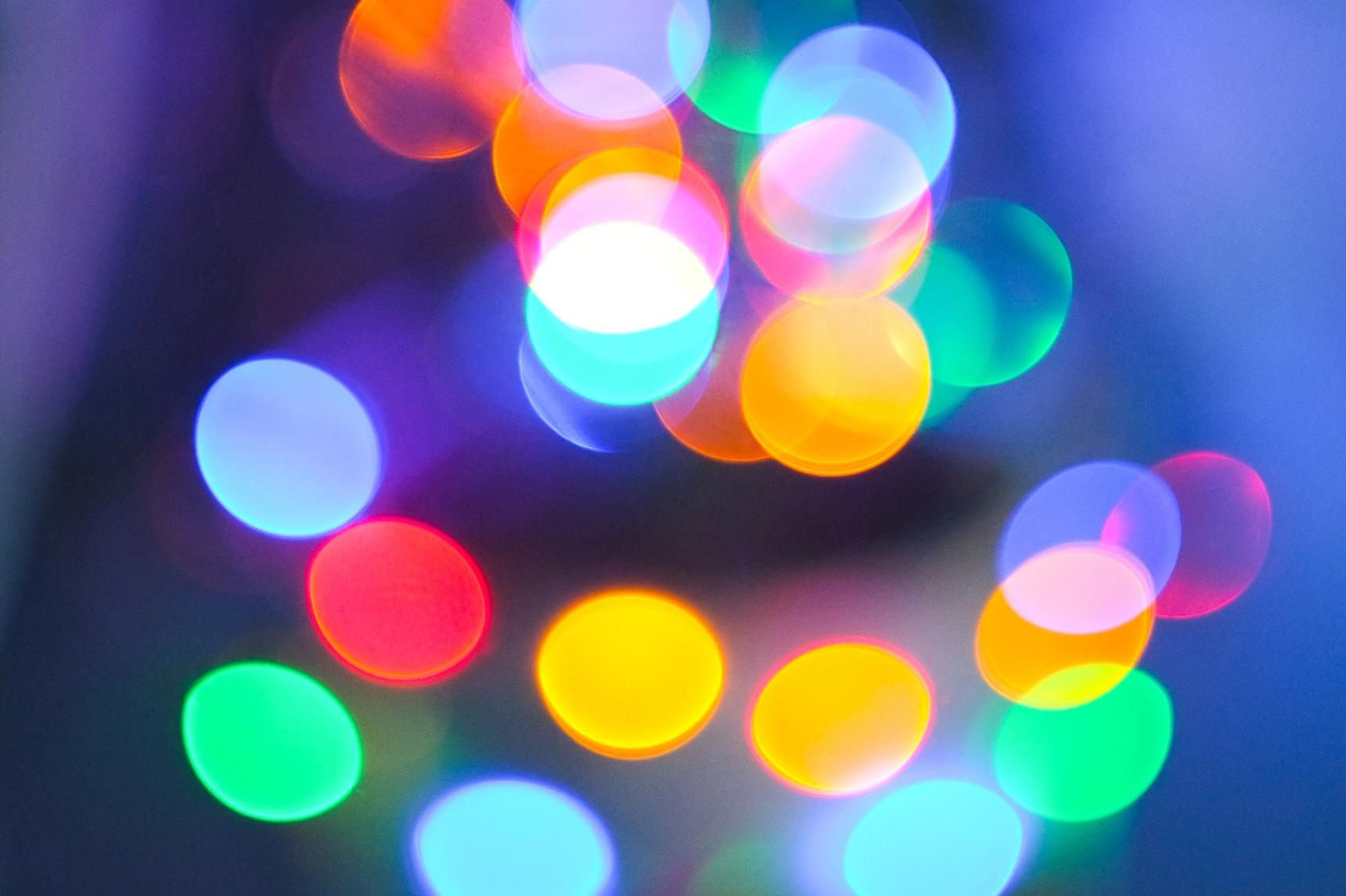 Defocused image of illuminated colorful Xmas lights