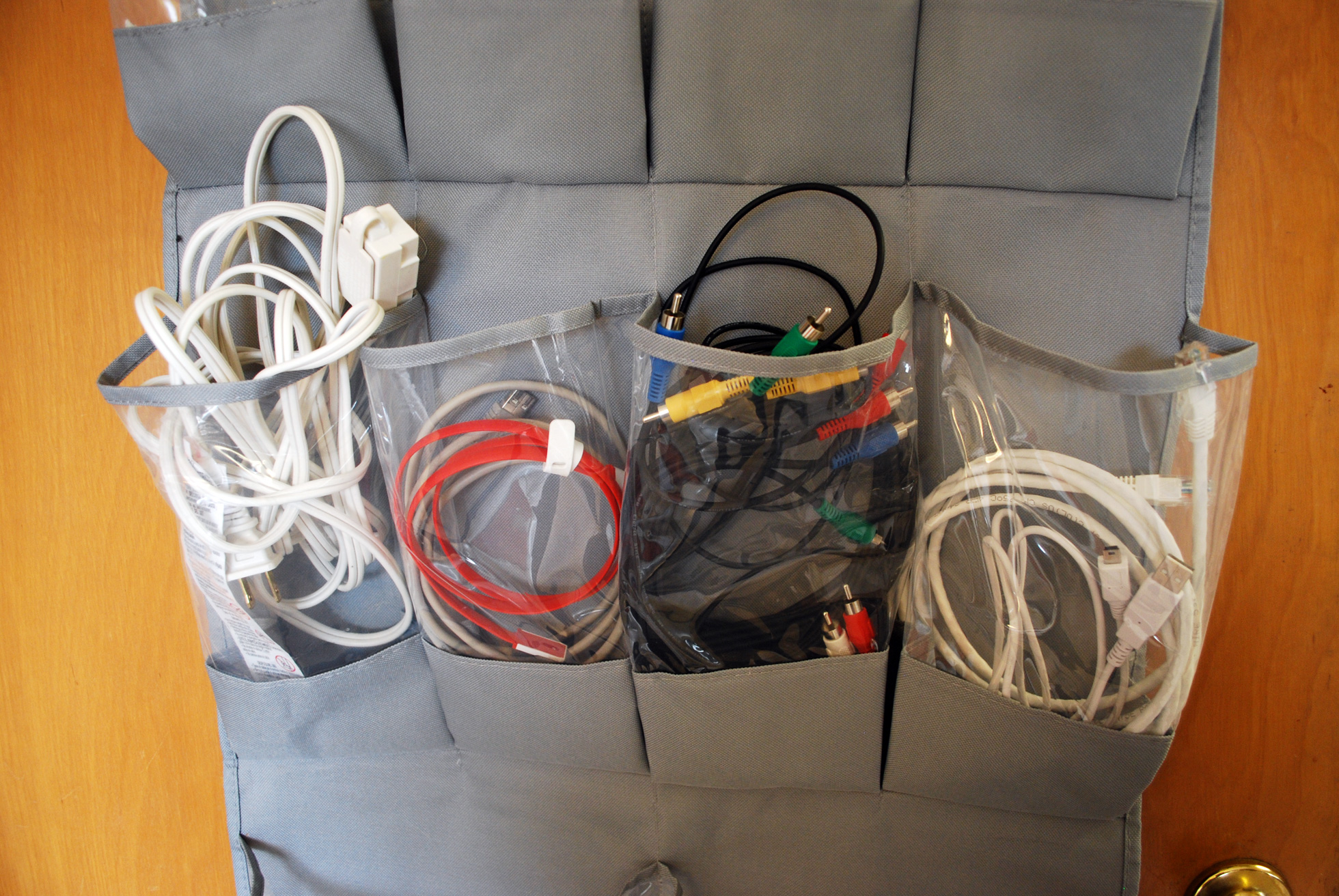 Over-the-door shoe organizer used to store computer cords